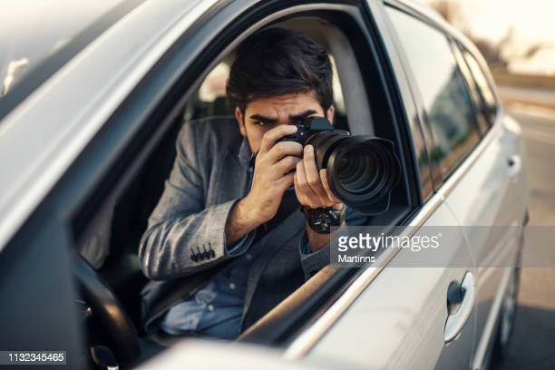 close-up - young man photorapher sitting in the car - stalker person stock photos and pictures