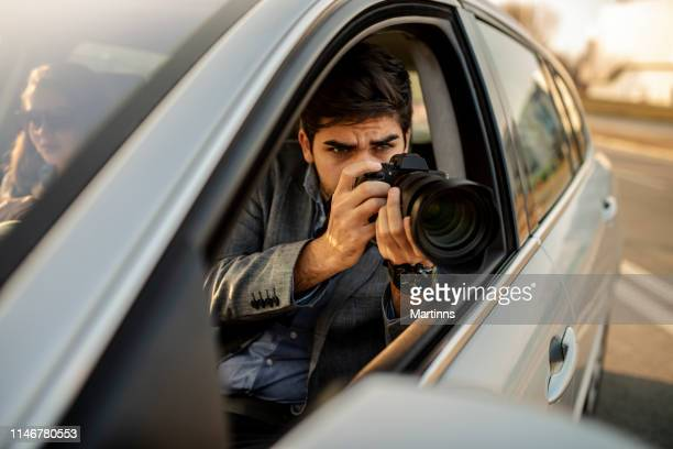 close-up - young man photorapher sitting in the car - surveillance stock pictures, royalty-free photos & images