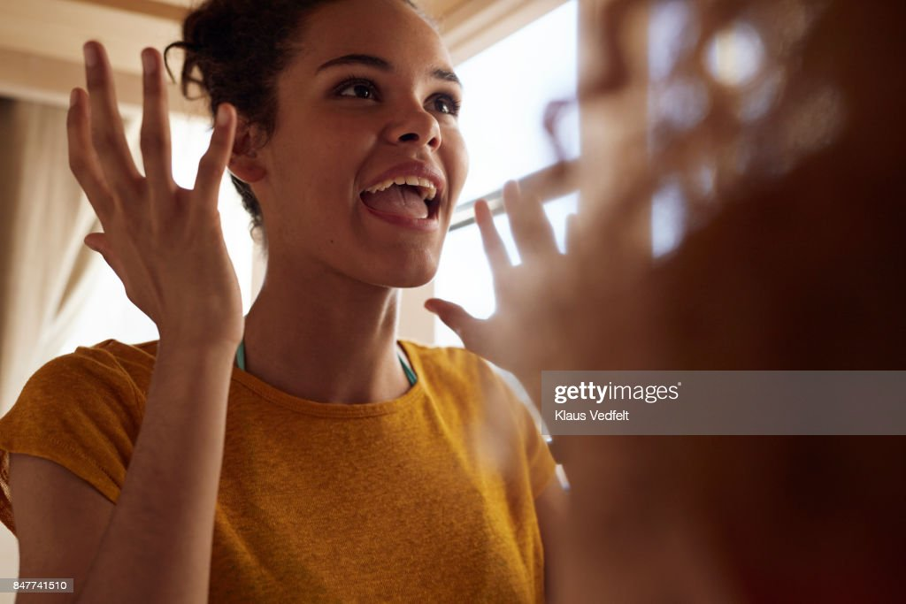 Close-up young women talking, while sitting in bunk bed : Stock Photo