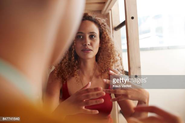 close-up young women talking, while sitting in bunk bed - discussion stock photos and pictures