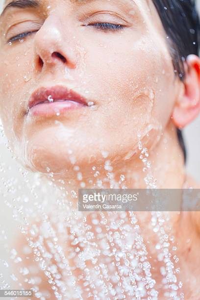 Closeups of a woman showering
