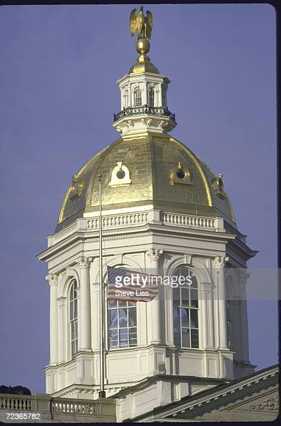 Closeups of State House dome with flag flying at halfmast after death of local teacher/astronaut Sharon Christa McAuliffe in Challenger disaster