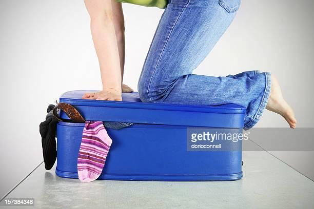 closing a suitcase
