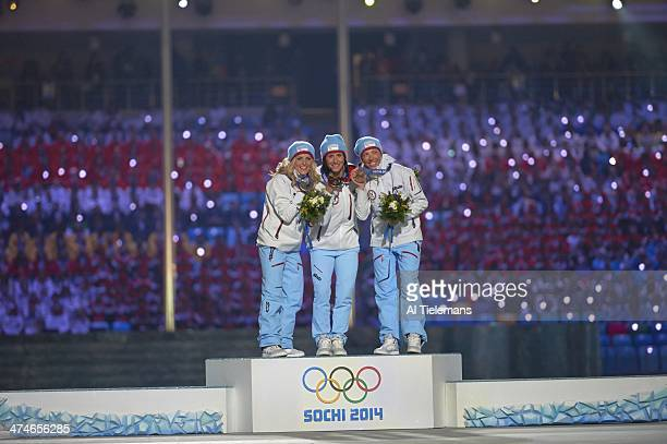 2014 Winter Olympics Norway Therese Johnaug Norway Marit Bjoergen and Norway Kristin Stoermer Steira victorious on medal stand after winning Women's...