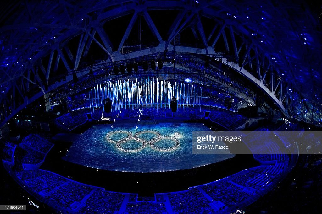Overall view of dancers in sparkling outfits forming Olympic rings during opening at Fisht Olympic Stadium. Fifth ring is closed. Erick W. Rasco X157804 TK1 R1 F52 )