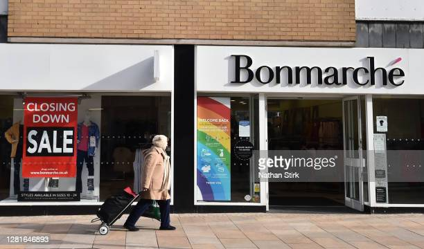 A closing down sign is seen in the window of retailers Bonmarche as a lady walks past the shop front on October 22 2020 in Hanley StokeonTrent