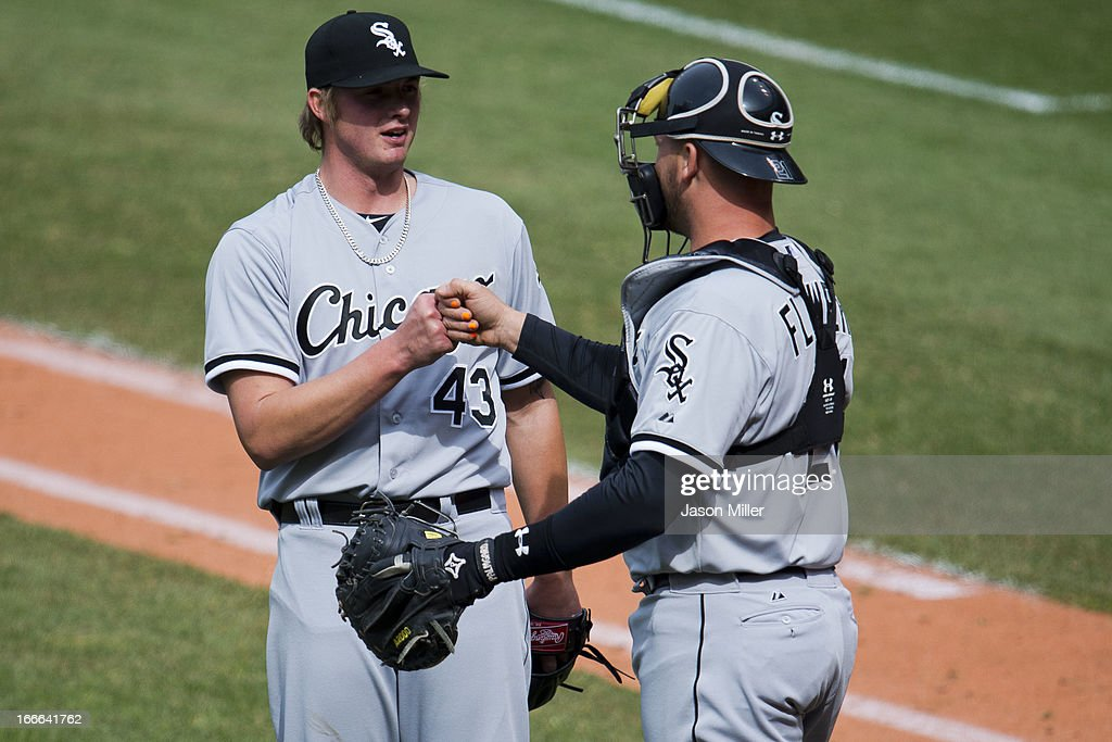 Closing pitcher Addison Reed #43 celebrates with catcher Tyler Flowers #21 of the Chicago White Sox after the White Sox defeated the Cleveland Indians at Progressive Field on April 14, 2013 in Cleveland, Ohio. The White Sox defeated the Indians 3-1.