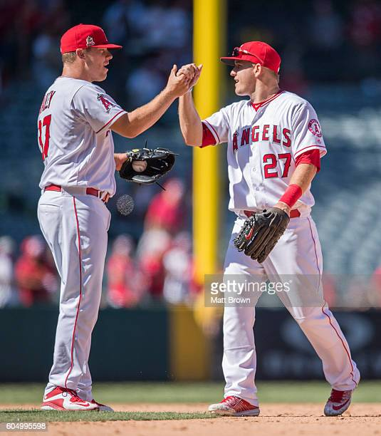 Closing pitcher Andrew Bailey and Mike Trout of the Los Angeles Angels of Anaheim celebrate after defeating the Texas Rangers 32 in the game at Angel...