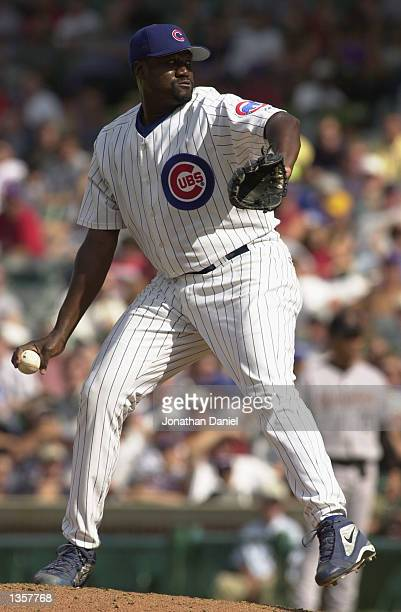 Closing pitcher Antonio Alfonseca of the Chicago Cubs throws against the Houston Astros in the ninth inning of the game on August 15 2002 at Wrigley...