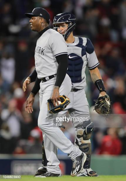 Closing pitcher Aroldis Chapman and catcher Gary Sanchez celebrate after their 6-2 win in Game Two of the American League Division Series against the...