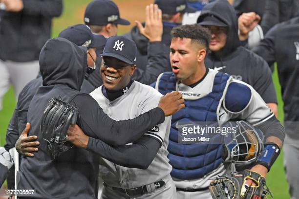 Closing pitcher Aroldis Chapman of the New York Yankees celebrates with teammates after the Yankees defeated the Cleveland Indians in Game Two of the...