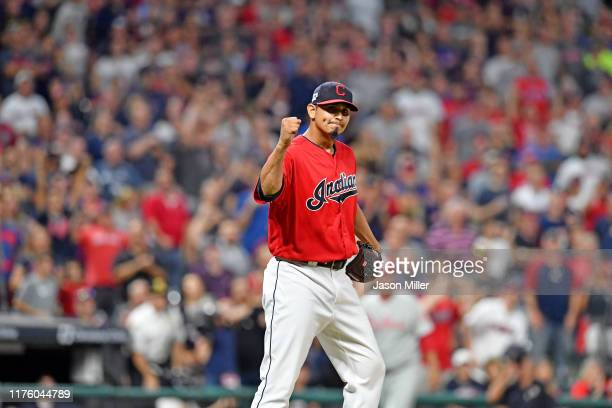 Closing pitcher Carlos Carrasco of the Cleveland Indians celebrates as Adam Haseley of the Philadelphia Phillies is thrown out at first to end the...