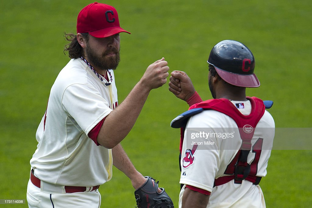 Closing pitcher Chris Perez #54 and catcher Carlos Santana #41 of the Cleveland Indians celebrate after the Indians defeated the Detroit Tigers at Progressive Field on July 7, 2013 in Cleveland, Ohio. The Indians defeated the Tigers 9-6.