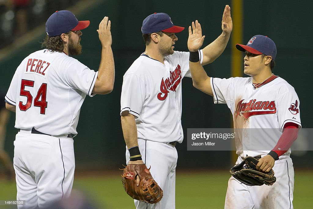 Closing pitcher Chris Perez #54 celebrates with Casey Kotchman #35 and Shin-Soo Choo #17 of the Cleveland Indians after the Indians defeated the Baltimore Orioles at Progressive Field on July 23, 2012 in Cleveland, Ohio. The Indians defeated the Orioles 3-1.