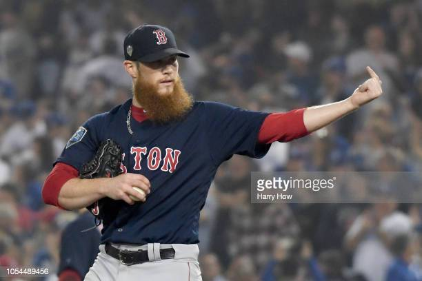 Closing pitcher Craig Kimbrel of the Boston Red Sox reacts after giving up a solo home run to Enrique Hernandez of the Los Angeles Dodgers in the...