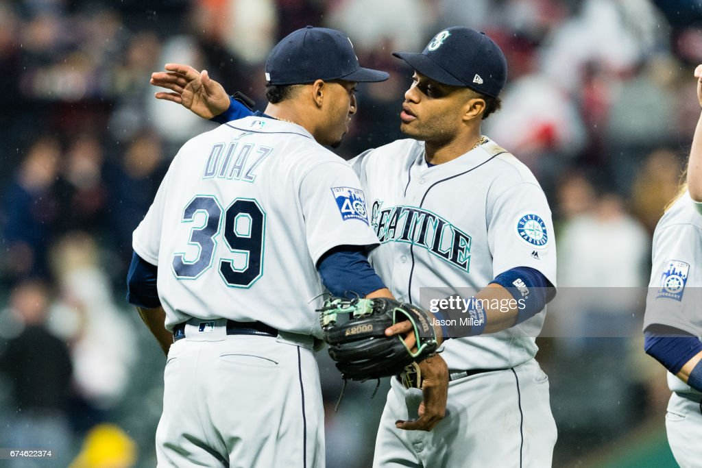 Closing pitcher Edwin Diaz #39 celebrates with Robinson Cano #22 of the Seattle Mariners after the Mariners defeated the Cleveland Indians at Progressive Field on April 28, 2017 in Cleveland, Ohio. The Mariners defeated the Indians 3-1.