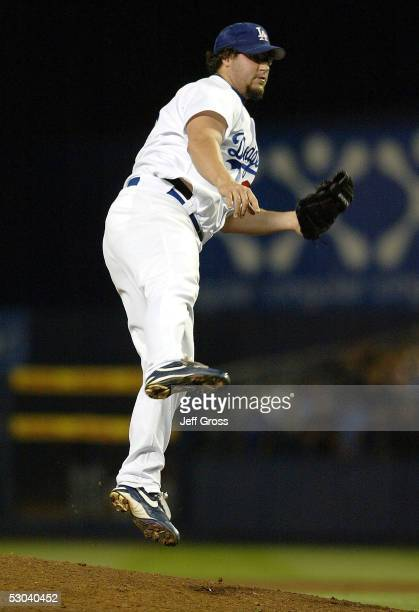 Closing pitcher Eric Gagne of the Los Angeles Dodgers jumps off the mound after delivering a pitch in the ninth inning against the Detroit Tigers at...