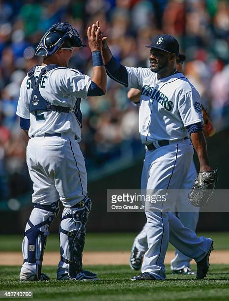 Closing pitcher Fernando Rodney of the Seattle Mariners is congratulated by catcher Jesus Sucre after defeating the Baltimore Orioles 43 at Safeco...