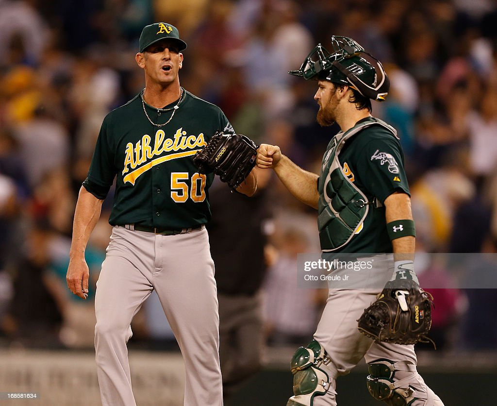 Closing pitcher Grant Balfour #50 of the Oakland Athletics celebrates with catcher Derek Norris #36 after defeating the Seattle Mariners 4-3 at Safeco Field on May 11, 2013 in Seattle, Washington.