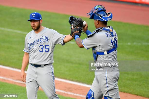 Closing pitcher Greg Holland celebrates with catcher Salvador Perez of the Kansas City Royals after Holland struck out three straight batters in the...