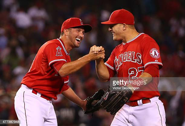 Closing pitcher Huston Street and Mike Trout of the Los Angeles Angels of Anaheim celebrate after their 41 against the Arizona Diamondbacks in their...