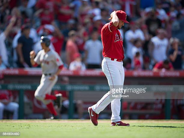 Closing pitcher Huston Street of the Los Angeles Angels of Anaheim reacts after allowing a goahead threerun home run to Dustin Pedroia of the Boston...