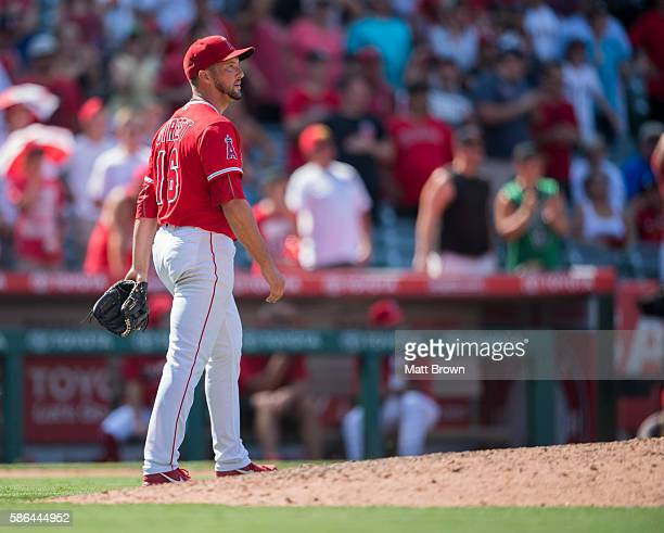 Closing pitcher Huston Street of the Los Angeles Angels of Anaheim reacts after allowing a single to Aaron Hill of the Boston Red Sox during the...