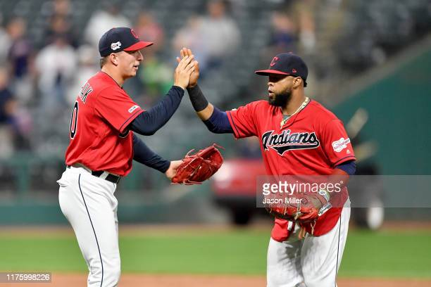 Closing pitcher James Karinchak celebrates with Carlos Santana of the Cleveland Indians after the Indians defeated the Detroit Tigers at Progressive...