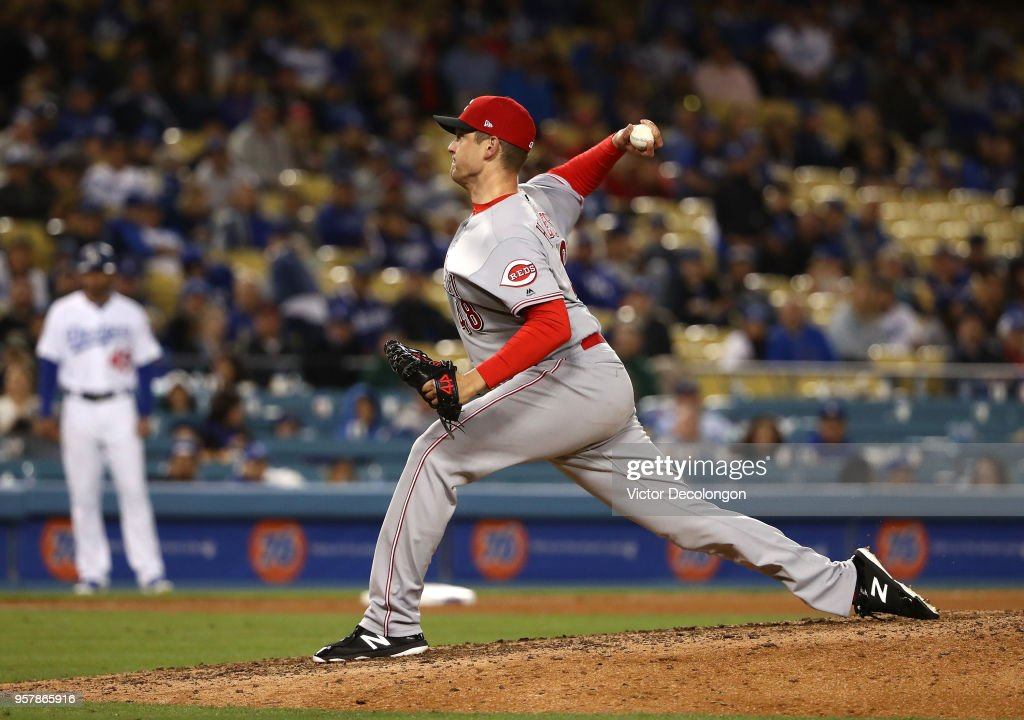 Closing pitcher Jared Hughes #48 of the Cincinnati Reds pitches in the ninth inning of the MLB game against the Los Angeles Dodgers at Dodger Stadium on May 12, 2018 in Los Angeles, California. The Reds defeated the Dodgers 5-3.