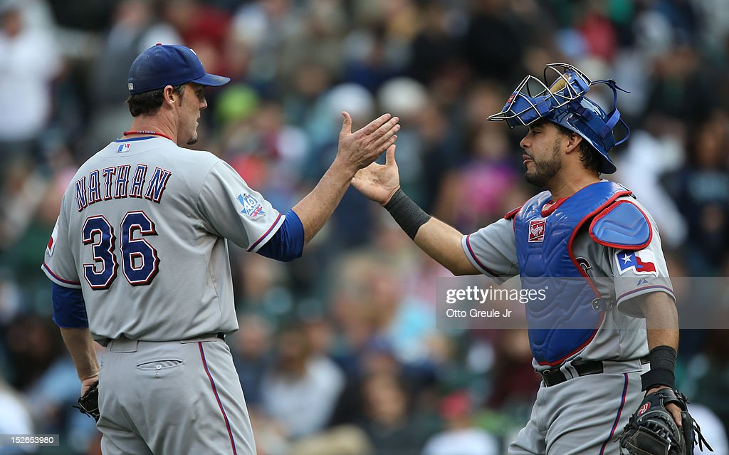 Closing pitcher Joe Nathan #36 of the Texas Rangers is congratulated by catcher Geovany Soto #8 after defeating the Seattle Mariners 3-2 at Safeco Field on September 23, 2012 in Seattle, Washington.