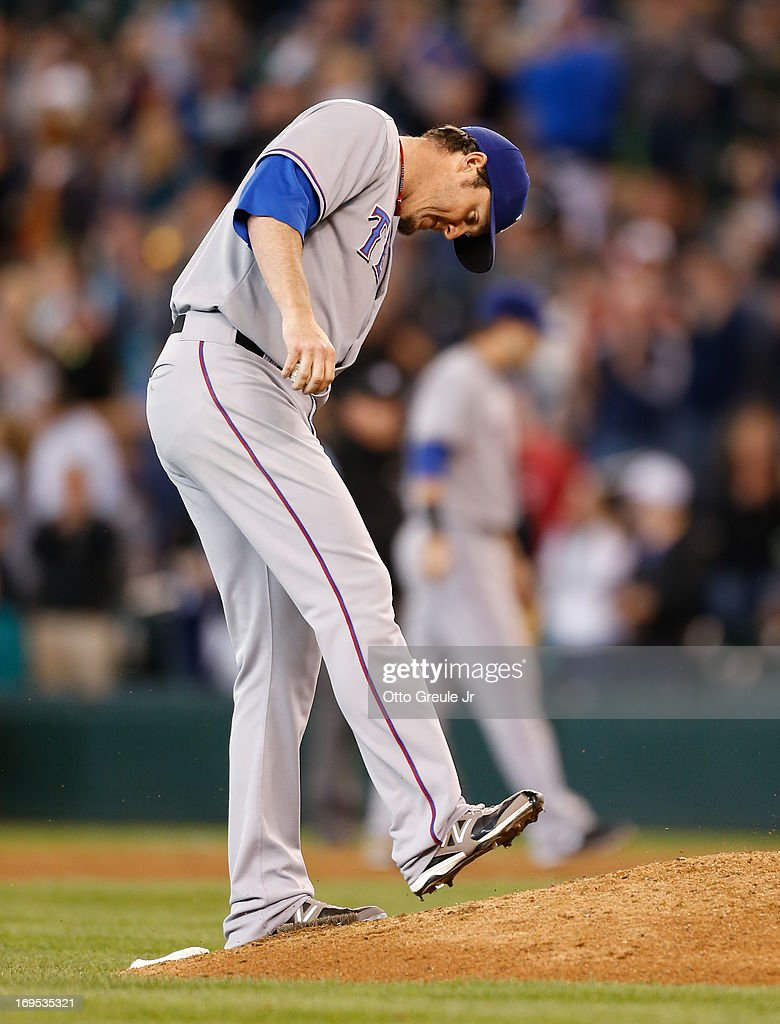 Closing pitcher Joe Nathan #36 of the Texas Rangers kicks the dirt after giving up a game-tying home run to Raul Ibanez of the Seattle Mariners in the eleventh inning at Safeco Field on May 26, 2013 in Seattle, Washington.