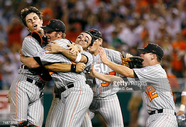 Closing pitcher Joe Paterson of the Oregon State Beavers is congratulated by teammates as they celebrate winning a second straight NCAA Championship...