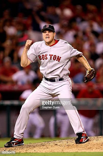 Closing pitcher Jonathan Papelbon of the Boston Red Sox celebrates after the last out against the Los Angeles Angels of Anaheim in game one of the...
