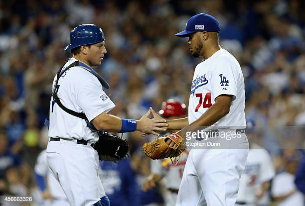Closing pitcher Kenley Jansen and catcher AJ Ellis of the Los Angeles Dodgers celebrates after their team's 32 win over the St Louis Cardinals in...
