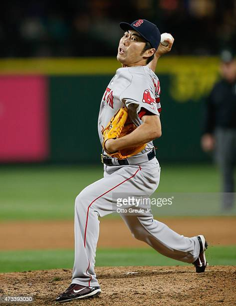 Closing pitcher Koji Uehara of the Boston Red Sox pitches against the Seattle Mariners in the ninth inning at Safeco Field on May 14 2015 in Seattle...