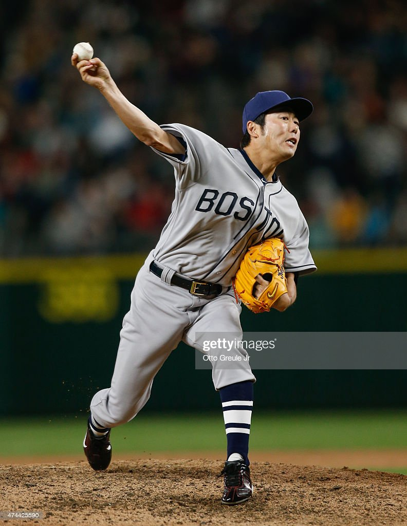 Closing pitcher Koji Uehara #19 of the Boston Red Sox pitches against the Seattle Mariners at Safeco Field on May 16, 2015 in Seattle, Washington.