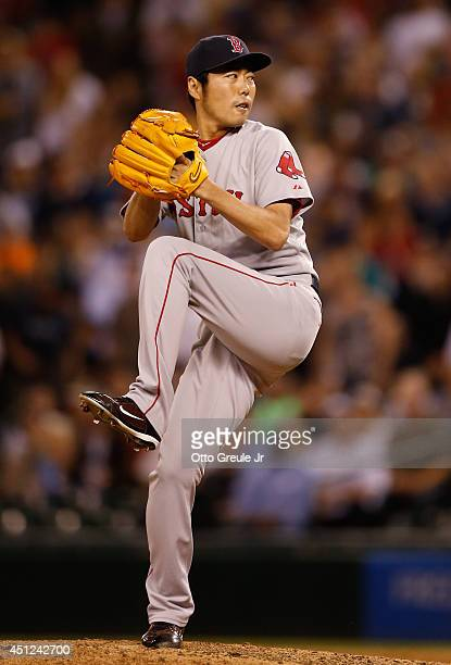 Closing pitcher Koji Uehara of the Boston Red Sox pitches in the ninth inning against the Seattle Mariners at Safeco Field on June 25 2014 in Seattle...