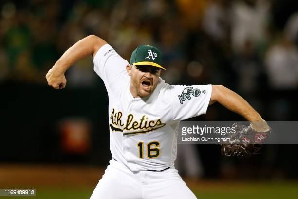 Closing pitcher Liam Hendriks of the Oakland Athletics celebrates after the final out of a win against the New York Yankees at Ring Central Coliseum...