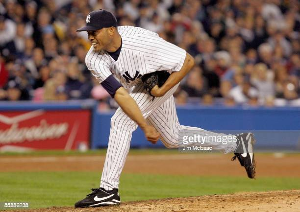 Closing pitcher, Mariano Rivera of the New York Yankees delivers a pitch in the eighth inning against the Los Angeles Angels of Anaheim during Game...