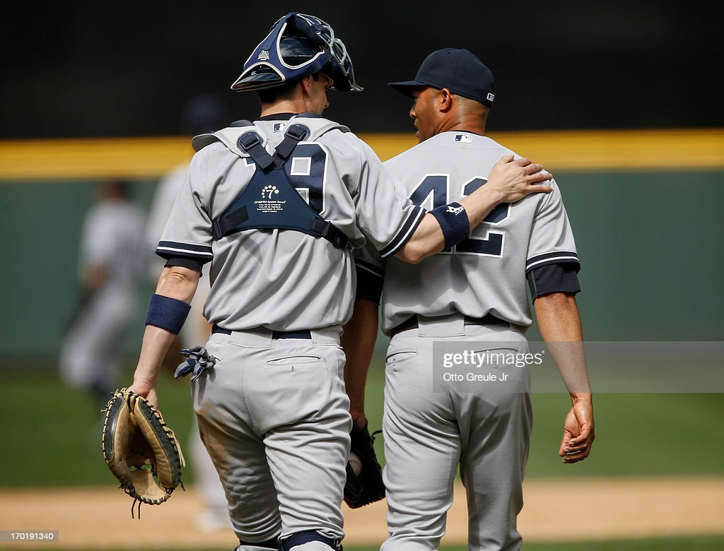 Closing pitcher Mariano Rivera #42 of the New York Yankees is congratulated by catcher Chris Stewart #19 after defeating the Seattle Mariners 3-1 at Safeco Field on June 8, 2013 in Seattle, Washington.