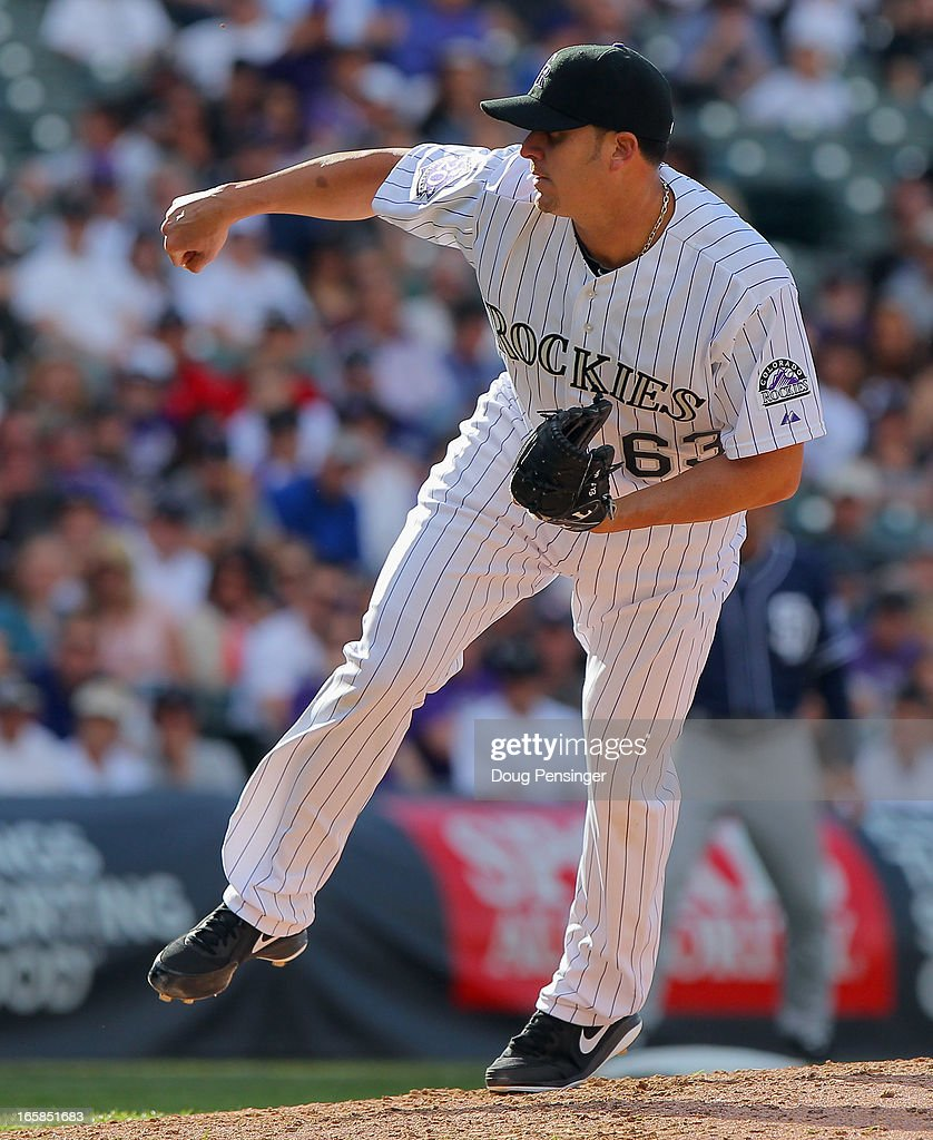 Closing pitcher Rafael Betancourt #63 of the Colorado Rockies works against the San Diego Padres during Opening Day at Coors Field on April 5, 2013 in Denver, Colorado. Betancourt earned a save as the Rockies defeated the Padres 5-2.