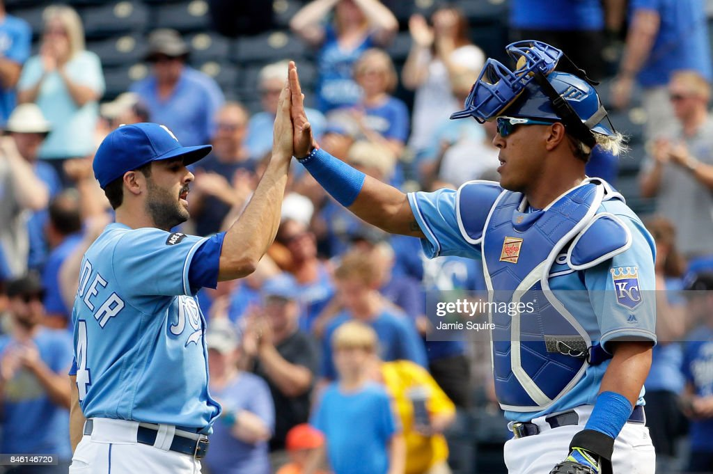 Closing pitcher Scott Alexander #54 of the Kansas City Royals is congratulated by Salvador Perez #13 after the Royals defeated the Chicago White Sox 4-3 to win the game at Kauffman Stadium on September 12, 2017 in Kansas City, Missouri.