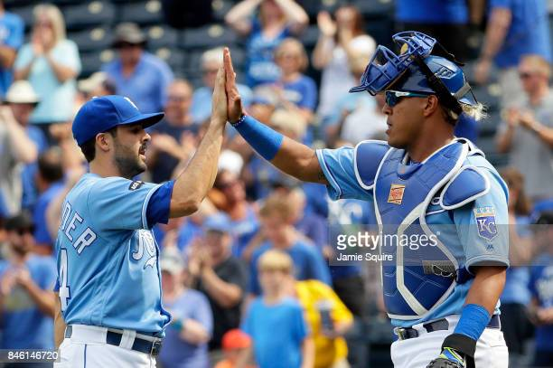 Closing pitcher Scott Alexander of the Kansas City Royals is congratulated by Salvador Perez after the Royals defeated the Chicago White Sox 43 to...