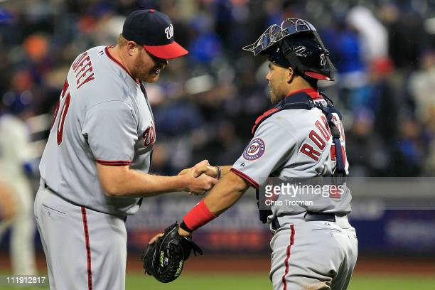 Closing pitcher Todd Coffey and catcher Ivan Rodriguez of the Washington Nationals celebrate after they won 62 against the New York Mets during the...