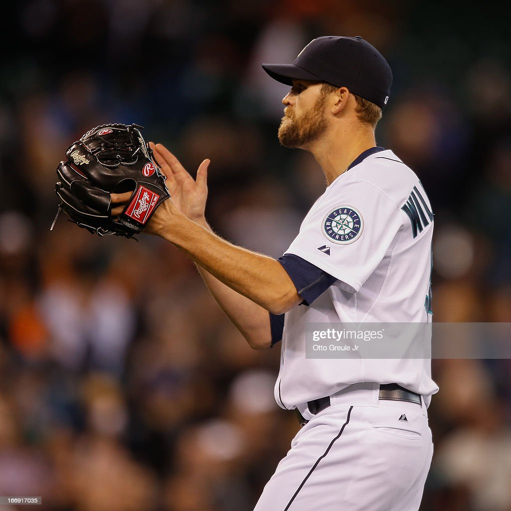 Closing pitcher Tom Wilhelmsen #54 of the Seattle Mariners celebrates after defeating the Detroit Tigers 2-0 at Safeco Field on April 18, 2013 in Seattle, Washington.