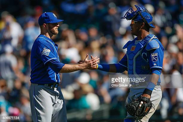 Closing pitcher Wade Davis of the Kansas City Royals is congratulated by catcher Salvador Perez after defeating the Seattle Mariners at Safeco Field...