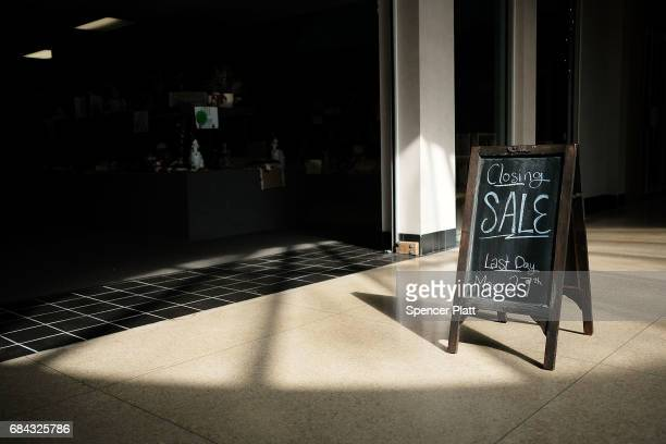 A 'closing sale' sign stands outside one of the last few open stores at the Schuylkill Mall which is scheduled to close in the coming months on May...