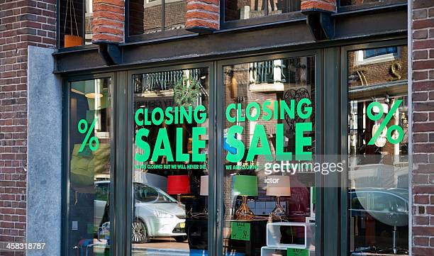closing sale signs in window - business closing stock photos and pictures