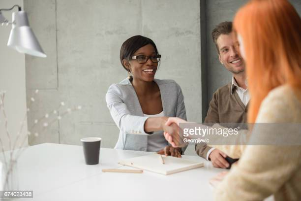 closing the deal - non verbal communication stock photos and pictures