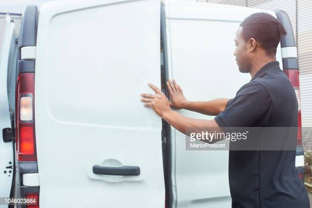 closing the doors on his van - vehicle door stock pictures, royalty-free photos & images